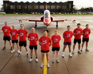 Red Arrows in formation wearing their running kit