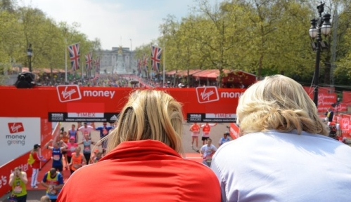 Holly and Richard Branson watching runners finish the 2011 Virgin London Marathon